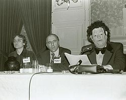 The famous Gay debate at the American Psychiatric Association in 1972: Barbara Gittings, Frank Kameny and a Gay psychiatrist (John E. Fryer) in a Halloween mask.