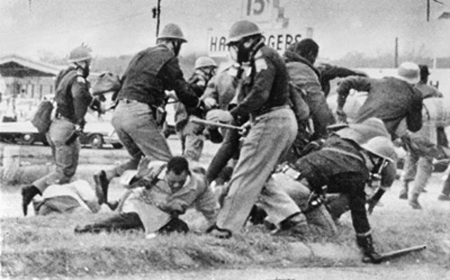 Civil rights marchers being beaten by Alabama State Troopers on the Edmund Pettus Bridge, Selma, 1965. This scene led to the passage of the Voting Rights Act later that year.